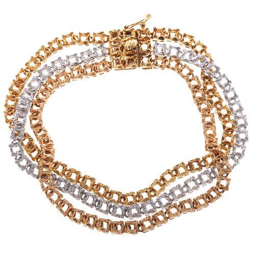 A Multi-Strand Bracelet in 18K Tri Color Gold