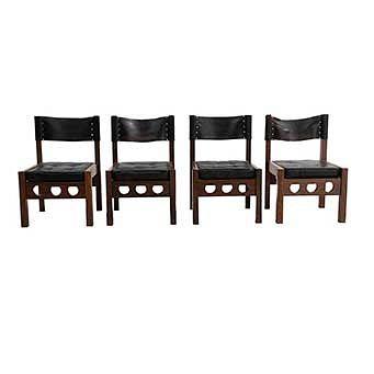 Lote de 4 sillas. México. SXX. Don S. Shoemaker. En talla de madera tropical. Con respaldos y asientos capitonados de piel color negro.