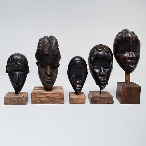 Group of Twenty-One African Wood Passport Masks