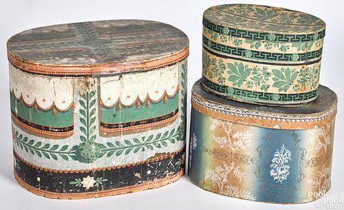 Three wallpaper hat boxes 19th c.
