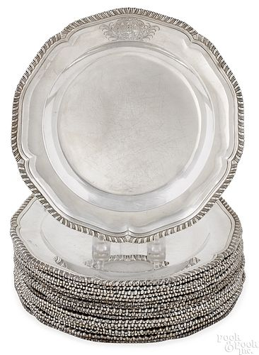 Set of eighteen English silver dinner plates