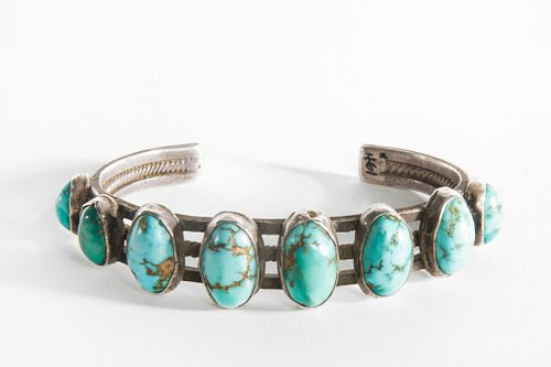 A Navajo Eight Stone Turquoise and Silver Bracelet, ca. 1910