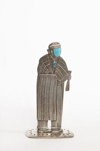 A Darryl Dean Begay Tufa Cast Silver Medicine Man