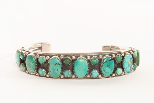 A Navajo Turquoise and Silver Row Bracelet
