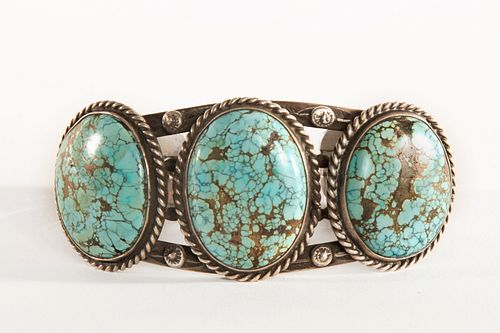 A Navajo Three Stone Turquoise and Silver Cuff, ca. 1950