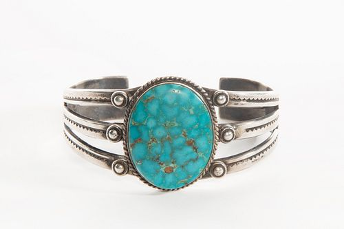 A Navajo Kingman Turquoise and Silver Cuff Bracelet, ca. 1950