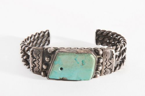 A Navajo Turquoise and Silver Cuff Bracelet, ca. 1930-1940