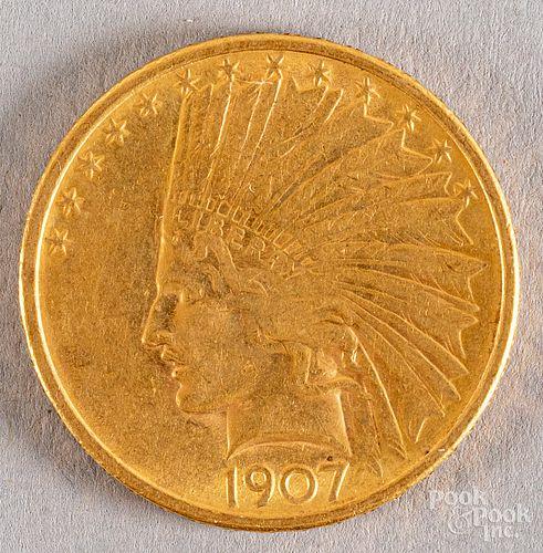 1907 ten dollar Indian Head gold eagle coin.