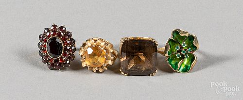 Four 14K gold and gemstone rings