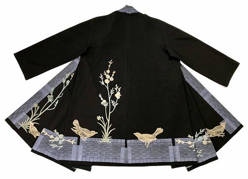 Black coat with small blossom tree, birds and a blue border.