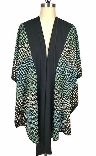 Black and turquoise ruana with printed dots.