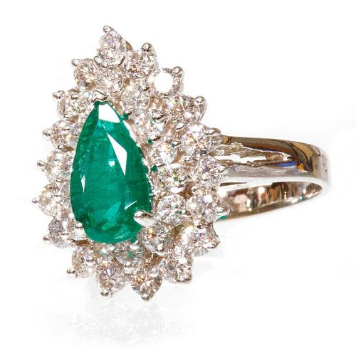 0.90 carat emerald weight and 1.20 carat total diamond weight ring