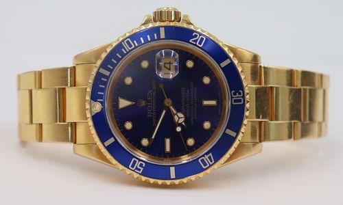 JEWELRY. Men's Rolex 18kt Gold Submariner Watch.