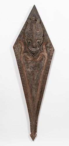 SOUTHEAST ASIAN, LARGE POLYCHROME CARVED SHIELD