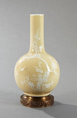Chinese Kuang Hsu Bottle Form Vase, c. 1900, with enameled floral and bird decoration, on a yellow ground, mounted on a pierced bras...