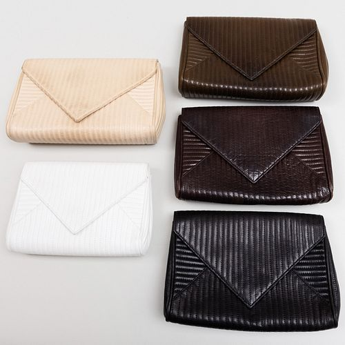 Group of Five Yves Saint Laurent Leather Clutches