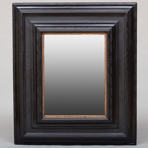 Large Flemish Baroque Style Ebonized and Parcel-Gilt Mirror