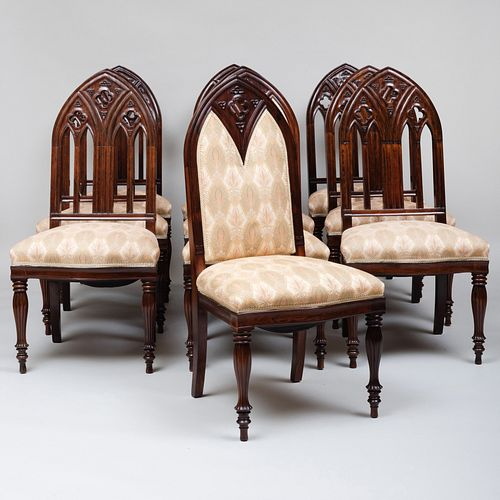 Set of Ten Continental Neo-Gothic Carved Rosewood Dining Chairs, Two of a Later Date