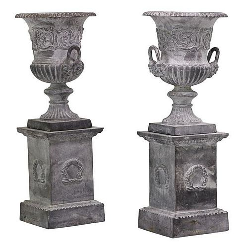 PAIR OF NEOCLASSICAL STYLE URNS ON PEDESTALS