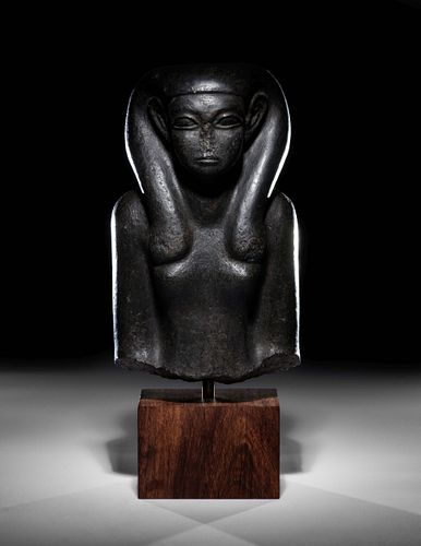 An Egyptian Basalt Portrait Bust of a Woman Height 10 1/4 inches.