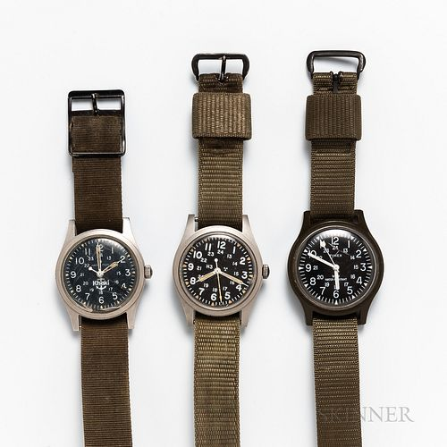 Three Military Wristwatches, green plastic molded Timex with black dial and lollipop sweep center seconds; Hamilton Mil-spec H3 46374B,