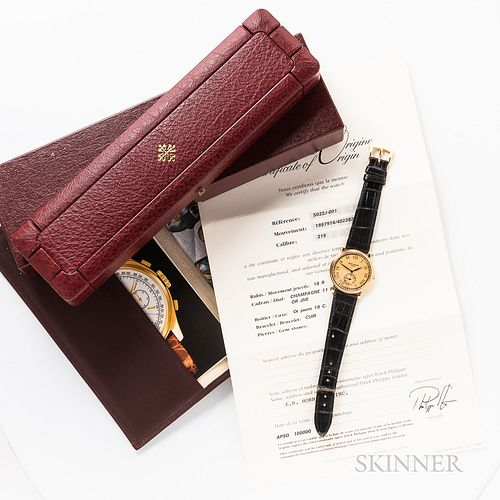 Patek Philippe 18kt Gold Reference 5022J Wristwatch with Box and Papers, engine-turned roman numeral champagne dial with running second