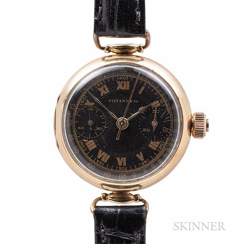 Tiffany & Co. 18kt Gold Monopusher Chronograph Wristwatch, attributed to Ulysse Nardin, first quarter 20th century, matte black dial wi