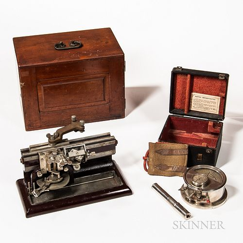 Two Early Scientific Instruments, Bausch & Lomb cherry cased Mikrotome number 2080 on a painted cast iron base, and a cased Oscillometr