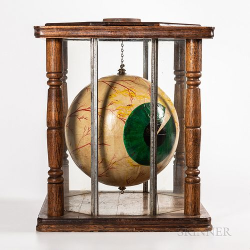 Ophthalmologist Trade Sign or Display Model, early 20th century, suspended hand-painted papier-mache eye model housed in an oak and oct