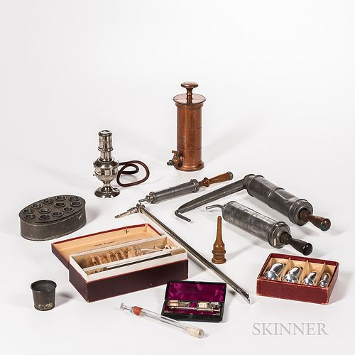 Collection of 19th and 20th Century Medical Instruments and Devices, a French dry cupping set in original cardboard box with interior l