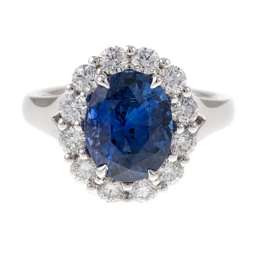 A 4.54 ct Sapphire & Diamond Halo Ring in Plat