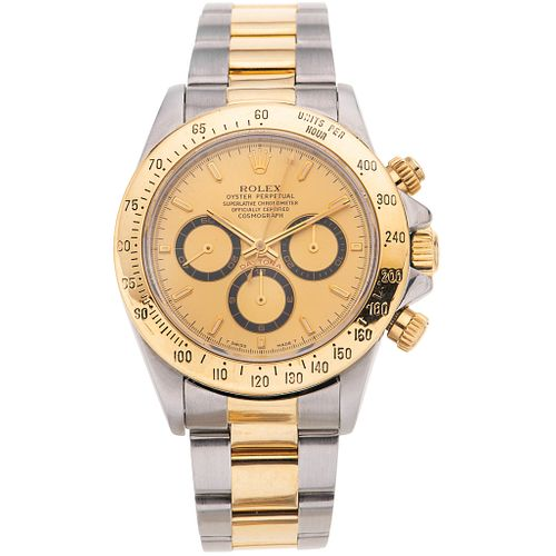 ROLEX OYSTER PERPETUAL COSMOGRAPH DAYTONA CHRONOGRAPH. STEEL AND 18K YELLOW GOLD. REF. 16523, CA. 1994 - 1995