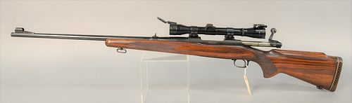 "Winchester Model 70 30-06 rifle, bolt action, SN: 215807, Lyman scope, book #555, lg. 44 1/2""."