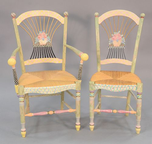"""Five hand painted Mackenzie Childs Light Flower Basket chairs with ceramic floral decorations and ratan seats, one arm chair and four side chairs. 40"""""""