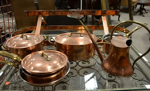 """Group of eight copper and brass handled cookware, center island pot hanger included, some stamped """"Williams Sonoma, France""""."""