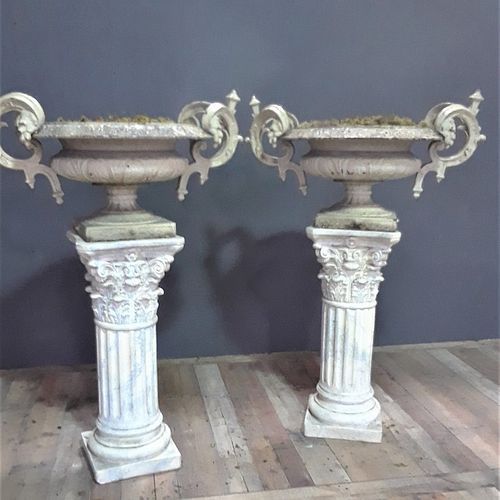 French cast iron urns with double scroll handles