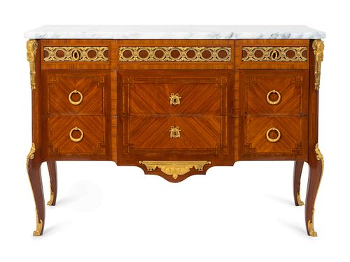 A Pair of Louis XVI Style Gilt-Bronze-Mounted Kingwood and Tulipwood Commodes Height 36 x length 52 x depth 19 1/4 inches.