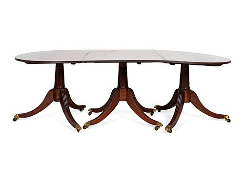 A Late George III Three Pedestal Mahogany Dining Table Height 29 2 1/4 x length 92 1/4 x depth 41 1/2 inches.  Two leaves, 27 3/4 inches each.