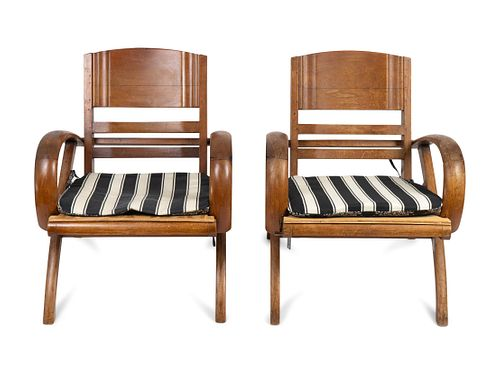 A Pair of British Colonial Teak Open Armchairs Heigh 28 3/4 x width 24 1/2 inches.