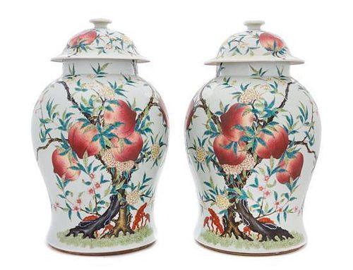 A Pair of Famille Rose Porcelain Baluster Vases and Covers Height of pair 16 inches.