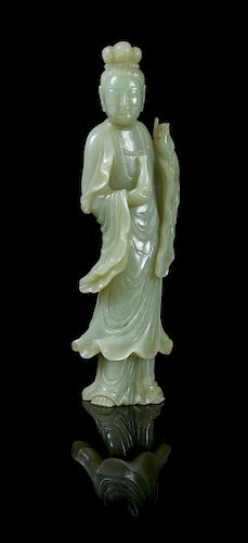 * A Celadon Jade Figure of Guanyin POSSIBLY 19TH CENTURY Height 9 inches.