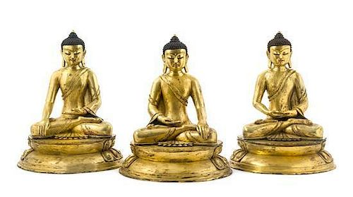 A Set of Three Gilt Bronze Figures of Buddha Height of set 17 inches.