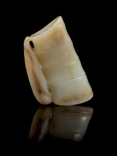 * A Carved Jade Toggle Length 2 3/8 inches.
