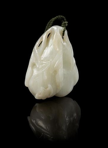 * A Carved Jade Pendant Length 2 1/4 inches.