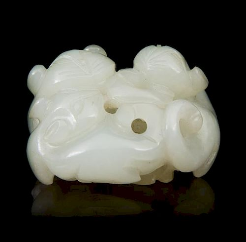 * A Carved Jade Toggle Length 1 3/4 inches.