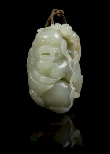 * A Carved Jade Toggle Length 2 3/4 inches.