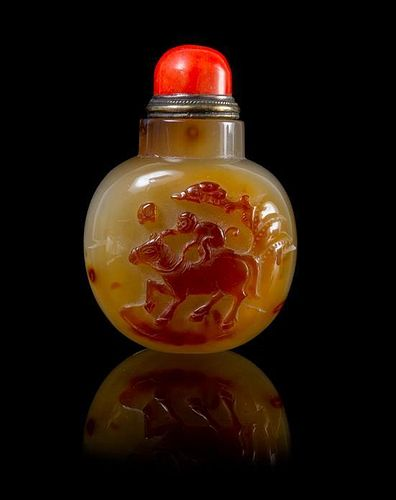 A Carved Agate Snuff Bottle Height 3 1/8 inches.