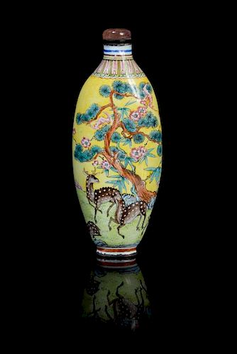 An Enamel on Copper Snuff Bottle Height 3 5/8 inches.