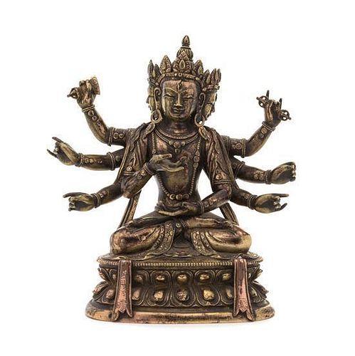 A Sino-Tibetan Gilt Bronze Figure of a Deity Height 7 inches.