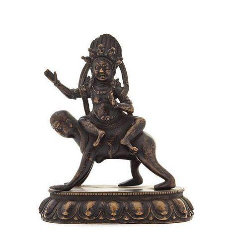 A Sino-Tibetan Bronze Figure of a Deity Height 6 1/8 inches.